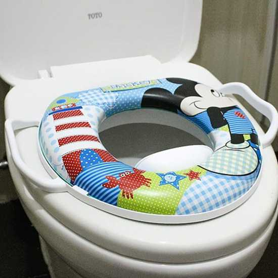 Bệ ngồi toilet hoạt hình cho bé có tay vịn và đệm ngồi