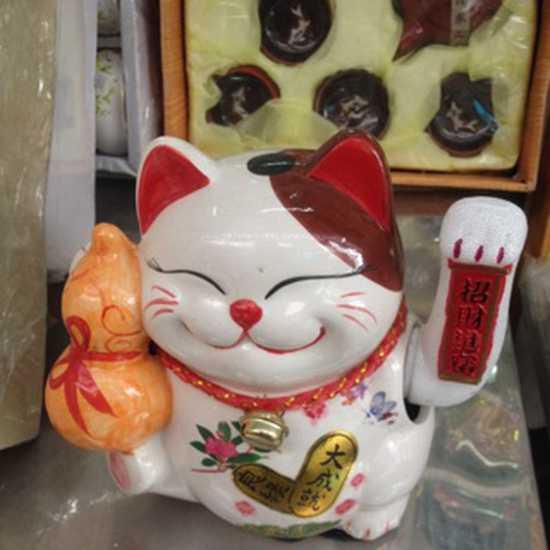Mèo vẫy tay chiêu lộc chiêu tài