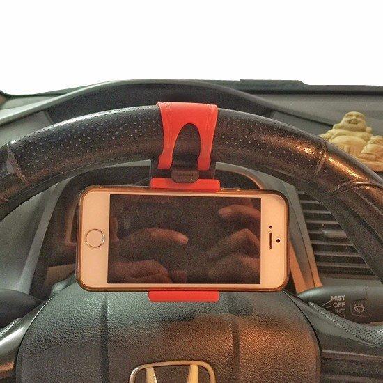 Giá đỡ kẹp điện thoại trên vô lăng tay lái ô tô (Đỏ)